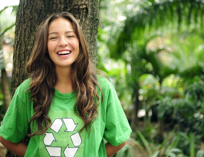 environmental-activist-in-the-forest-wearing-recycle-t-shirt